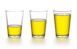 烹调杯子评定的油 免版税库存图片