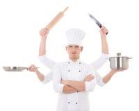 烹调概念-厨师制服的年轻人有六手holdin的 免版税库存照片