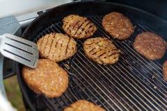 烹调烤汉堡炸肉排背景 免版税库存照片