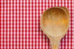 烹调的木匙子有红色白色背景 库存照片