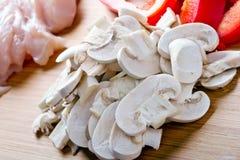 烹调的被切的mashrooms 免版税库存照片