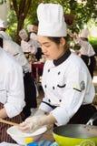烹调竞争学校业务管理学生(小辈铁厨师) 免版税库存照片