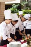 烹调竞争学校业务管理学生(小辈铁厨师) 库存照片