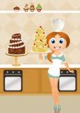 烹调蛋糕的妇女 免版税库存照片