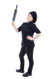 烹调被隔绝的黑一致的举行的烘烤滚针的妇女 免版税库存图片