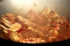 烹调,在咖喱粉的混乱油煎的螃蟹是顶十普遍的T 免版税库存照片