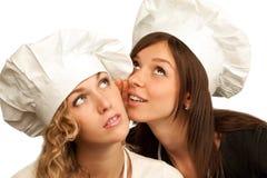 烹饪器材秘密共享他们 免版税图库摄影