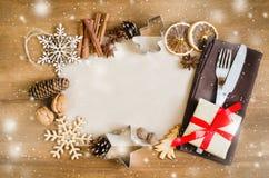 烹饪的背景 与空的纸的圣诞节明信片 库存照片