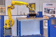 焊接和喷洒的机器人系统 库存图片