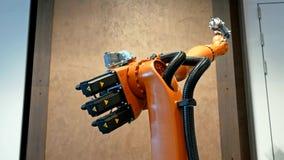 焊接和聚集的产业机器人胳膊 免版税库存图片