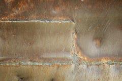 焊接的缝老铁背景 免版税图库摄影