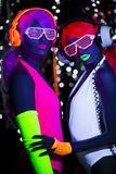 焕发紫外霓虹性感的迪斯科女性网络玩偶 免版税库存图片