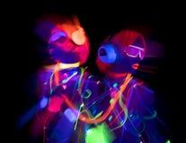 焕发紫外霓虹性感的迪斯科女性网络玩偶 图库摄影