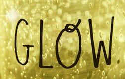 焕发-在徒手画写的词焕发在金黄bokeh构造了与闪闪发光的背景 向量例证