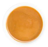 焦糖调味汁的部分在板岩平板的 免版税库存图片