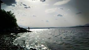 仍然等待的渔夫 免版税图库摄影