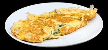 煎蛋卷用有机菠菜、在bl隔绝的乳酪和蘑菇 库存照片