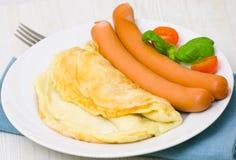 煎蛋卷用香肠 库存照片
