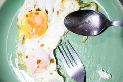 煎蛋被吃 库存图片