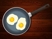 煎锅怂恿早餐木桌 库存照片