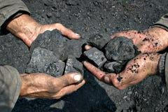 煤矿工人在手上  库存照片