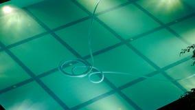 照明晚上池游泳 库存照片
