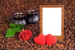 照片、咖啡和心脏的框架 库存图片