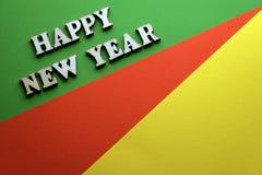 照片在绿色红色黄色背景的新年 免版税库存图片