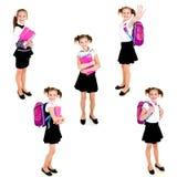 照片微笑的愉快的学校女孩的汇集 库存图片