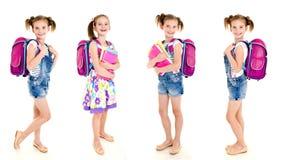 照片微笑的愉快的学校女孩的汇集 免版税库存图片