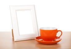 照片框架和咖啡杯 免版税库存照片