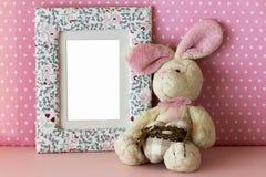 照片框架用女用连杉衬裤兔子 免版税库存照片