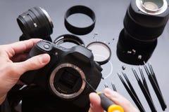 照片照相机修理集合 维护支持 免版税库存照片