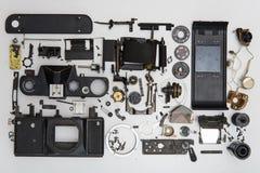 照片照相机被拆卸的零件 免版税库存照片