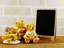 照片的逗人喜爱和时髦的烙记的嘲笑与玩具熊 图库摄影