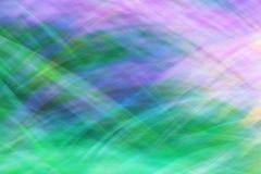 照片艺术,明亮的五颜六色的条纹提取在蓝色的背景, 免版税库存图片