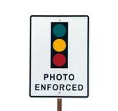 照片被强制执行的红绿灯标志 免版税图库摄影