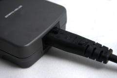 照相机充电器 免版税图库摄影