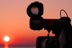 照相机和太阳面对面 免版税图库摄影