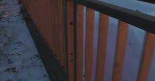 照相机在街道上的冬天移动并且去除栏杆 POV录影4k 股票视频