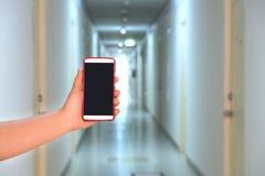 照相机电话捕获旅馆走廊 免版税库存照片