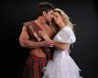 照相机的性感的夫妇姿势 库存照片