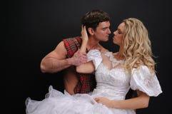 照相机的性感的夫妇姿势 免版税库存图片