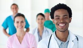 照相机种族医疗多人微笑 图库摄影