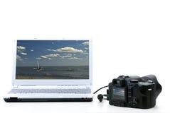 照相机笔记本照片 免版税图库摄影