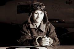 照相机飞行员微笑的年轻人 库存照片