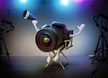 照相机DSLR On A主任电影布景 免版税库存图片