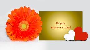 照顾` s与文本的天卡片在黄色信件,五颜六色的大丁草雏菊,心脏 免版税图库摄影