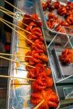 煮沸的微小的章鱼卖了在西龟市场上在京都 免版税库存照片