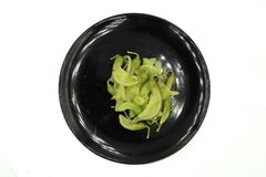 煮沸的绿色agasta:大花的Sesbania,Aeschynomene、agati或者蜂鸟树 能吃这些花作为菜或草本 免版税库存照片